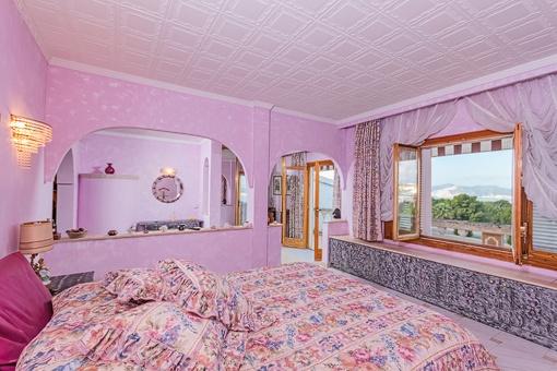 Schlafzimmer mit herrlichem Landschaftsblick