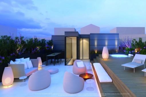 Beeindruckende Dachterrasse mit Lounge bei Nacht