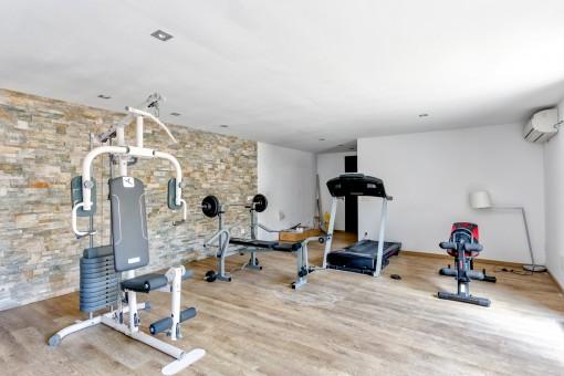 Fitnessraum im separaten Gästeapartment