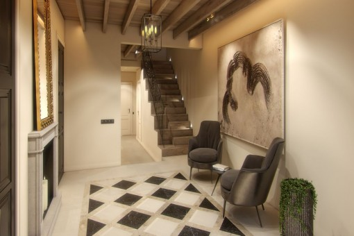 Treppenaufgang und Eingangsbereich mit Holzdeckenbalken