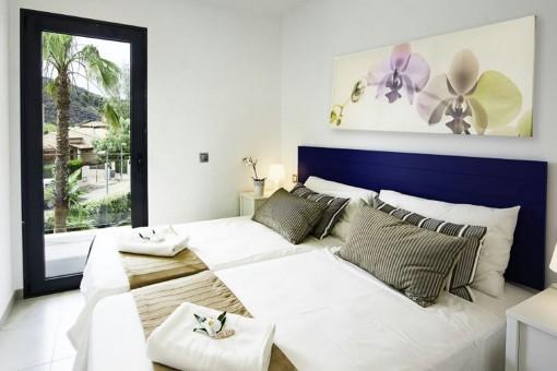 Eines von 3 konfortablen Schlafzimmern