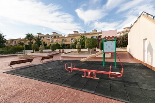 Gemeinschaftsbereich mit Spielplatz
