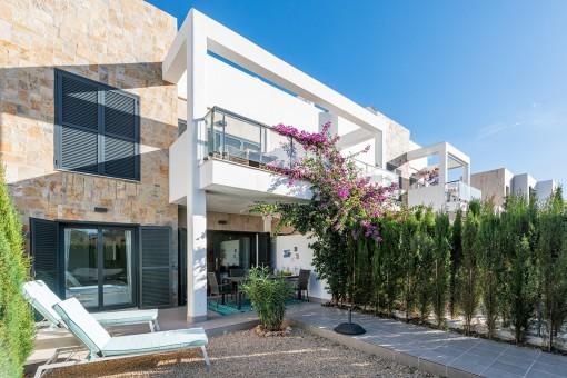 Schöne Neubauwohnung mit Garten in Poolnähe in Cala Murada