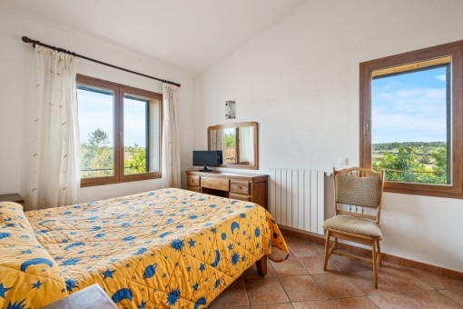 Schlafzimmer mit Landschaftsblick